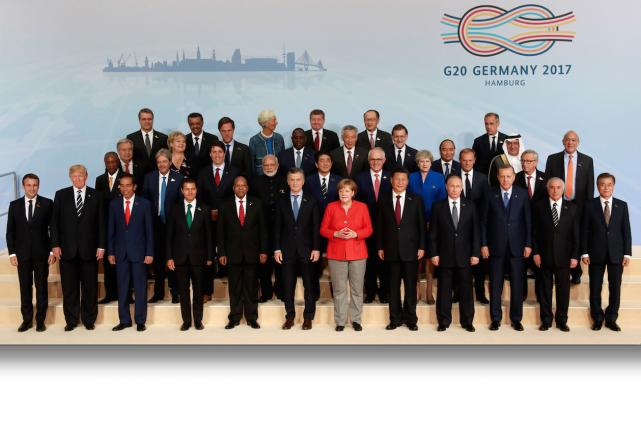 La photo de famille du G20, où l'on... (AFP, Odd Andersen)