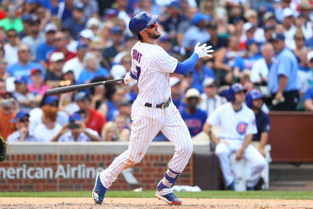Kris Bryant a frappé une longue balle en... (Photo Mark J. Rebilas, USA TODAY Sports)