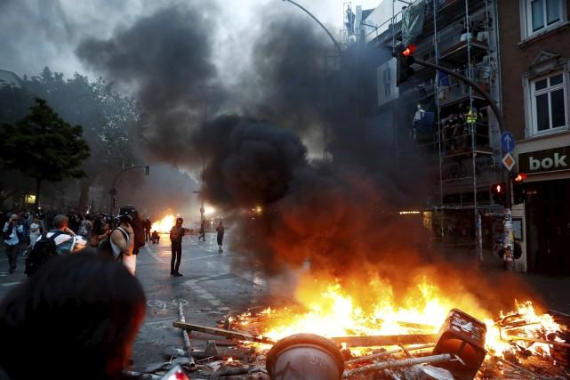 La première journée du sommet du G20 a... (AFP, Odd Andersen)