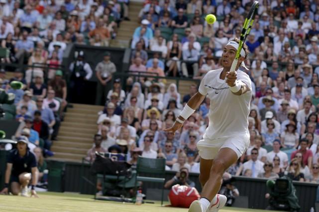 Nadal a avancé à la ronde suivante grâce... (AP)