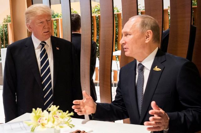Donald Trump a rencontréVladimir Poutine vendredi à Hambourg.... (Photo Steffen Kugler, REUTERS)