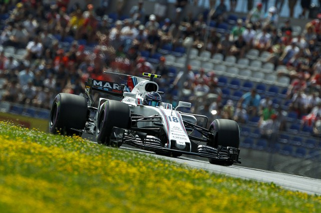 Lance Stroll... (PHOTO ERWIN SCHERIAU, AFP/APA)