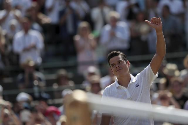 Milos Raonic s'est illustré à Wimbledon, samedi, réalisant... (AFP, Daniel Leal-Olivas)