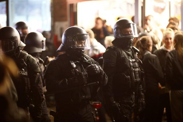 Depuis le début du G20, jeudi dernier, un... (Photo Hannibal Hanschke, REUTERS)