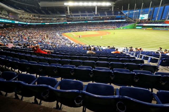 Aux parties des Marlins, à Miami, plusieurs bancs... (AP, Wilfredo Lee)