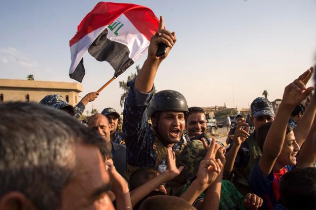 Le premier ministre irakien, Haider al-Abadi, a félicité... (PHOTO AFP)