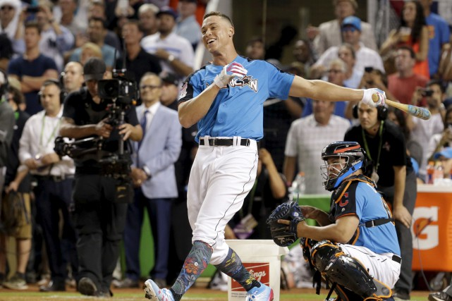 New York Yankees' Aaron Judge smiles as he... (AP)