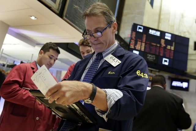 Pour expliquer la bonne disposition de la Bourse... (AP)