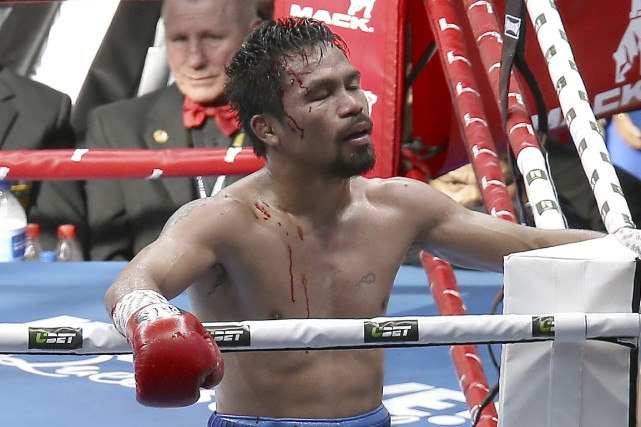 Manny Pacquiao s'est incliné face à Jeff Horn, le... (Photo Tertius Pickard, AP)