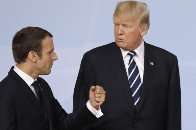 Jeudi, Emmanuel Macron déroule le tapis rouge pour... (AP)