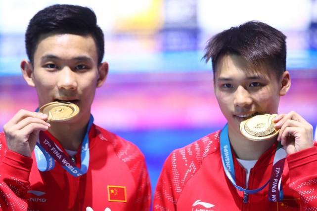 Chen Aisen et Yang Hao, champions olympiques en... (PHOTO REUTERS)