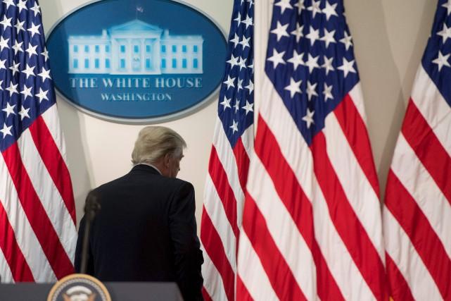 plusieurs grandes promesses faites par Donald Trump restent... (AFP, Saul Loeb)