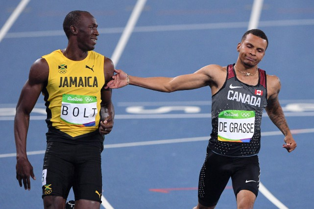 Usain Bolt et Andre De Grasse... (PHOTO ARCHIVES LA PRESSE CANADIENNE)
