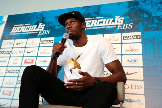 La légende du sprint Usain Bolt souhaite réaliser... (AFP, Valery HACHE)