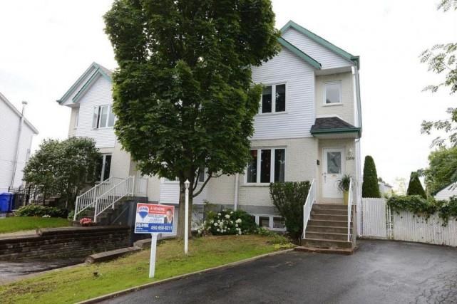 La maison blanche est très semblable à sa... (Photo fournie par Centris)