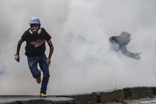 Le débrayage du transport collectif semblait avoir paralysé... (PHOTO JUAN BARRETO, AFP)