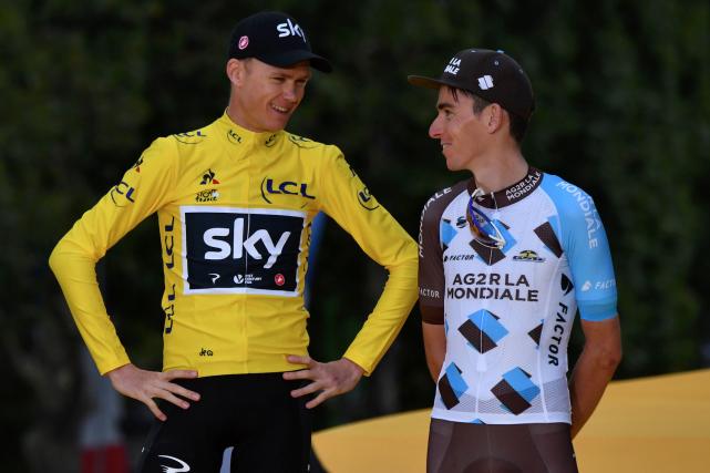 Le champion du Tour de France, Chris Froome... (AFP, Philippe Lopez)