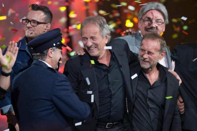 MichelCôté (au centre) a reçu beaucoup d'amour lors... (Photo OlivierJean, La Presse)