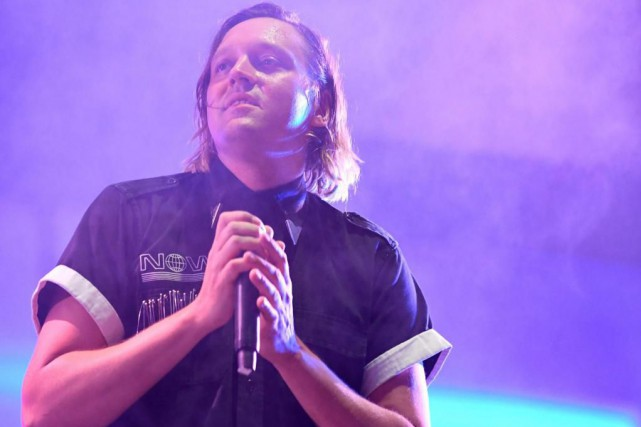 Win Butler en concert avec Arcade Fire au... (PHOTO FRED TANNEAU, ARCHIVES AGENCE FRANCE-PRESSE)