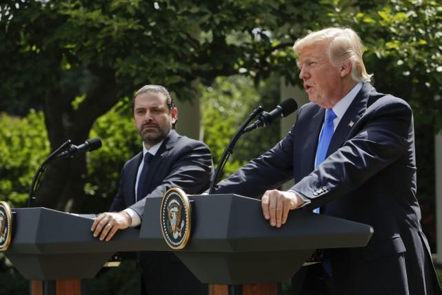 Le président américain Donald Trump (à droite) a... (Photo Pablo Martinez Monsivais, AP)