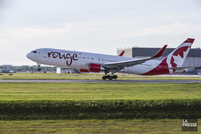 Un Ontarien qui avait voulu ouvrir la porte d'un avion d'Air Canada en plein... (Photo Hugo-Sébastien Aubert, La Presse)