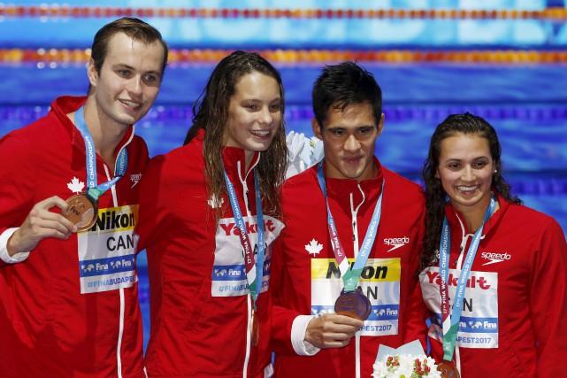 L'équipe canadienne formée de Kylie Masse, Richard Funk,... (Darko Bandic, Associated Press)