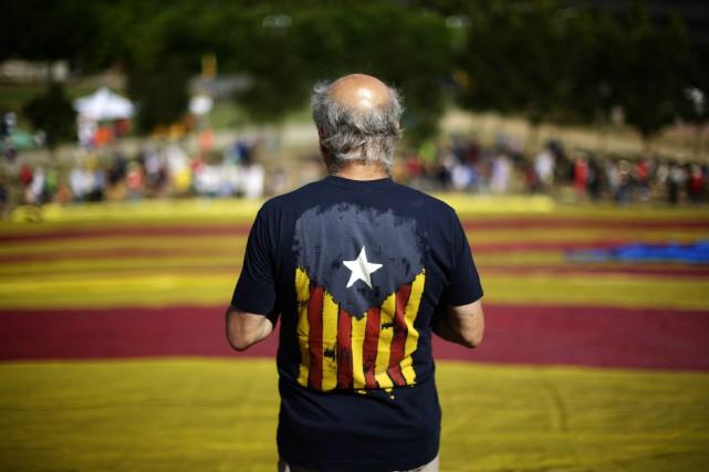 Selon un récent sondage, 49,4% des Catalans sont... (AP)