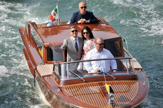 George Clooney est attendu sur le tapis rouge... (Archives AP, Luigi Costantini)
