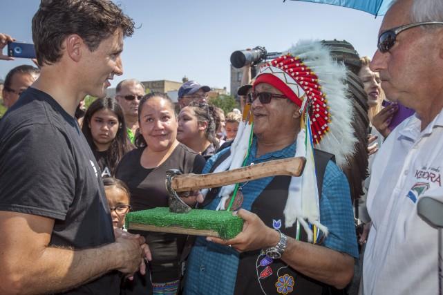 Le premier ministre canadien participait vendredi à un... (La Presse canadienne, Tom Thomson)