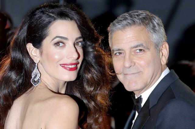 Amal et George Clooney... (Archives AP, François Mori)