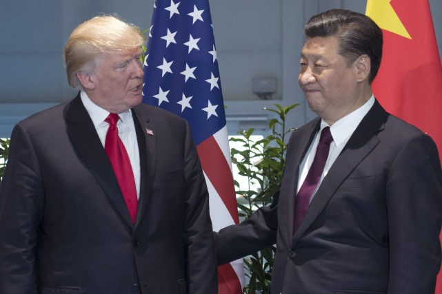 Donald Trump en compagnie du président chinois Xi... (Photo archives AP)