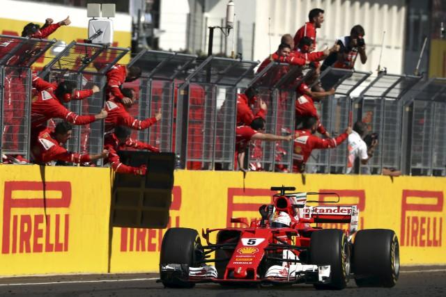 Sebastian Vettel a signé sa 46e victoire en... (AFP, Andrej Isakovic)