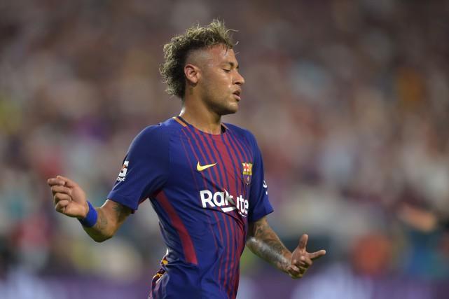 La vedette du soccer Neymar alimente depuis quelques... (AFP, Hector Retamal)