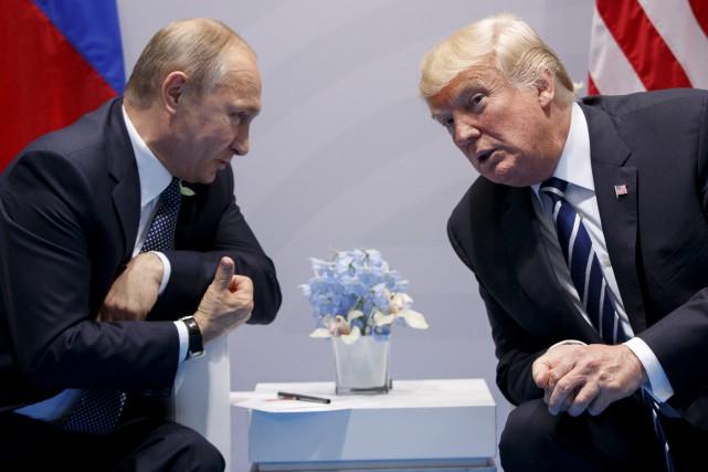 Le président russe Vladimir Poutine et Donald Trump... (Archives AP, Evan Vucci)