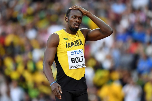 Usain Bolt a étébattu dans sa demi-finale par... (PHOTO KIRILL KUDRYAVTSEV, AGENCE FRANCE-PRESSE)