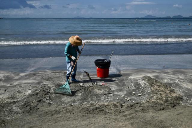 La fuite d'huile de palme est consécutive à... (Photo ANTHONY WALLACE, Agence France-Presse)