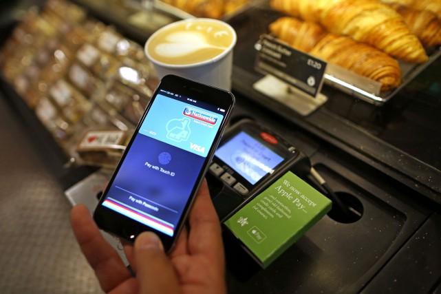 Les services de paiements électroniques sont de plus... (Photo Chris Ratcliffe, Bloomberg)