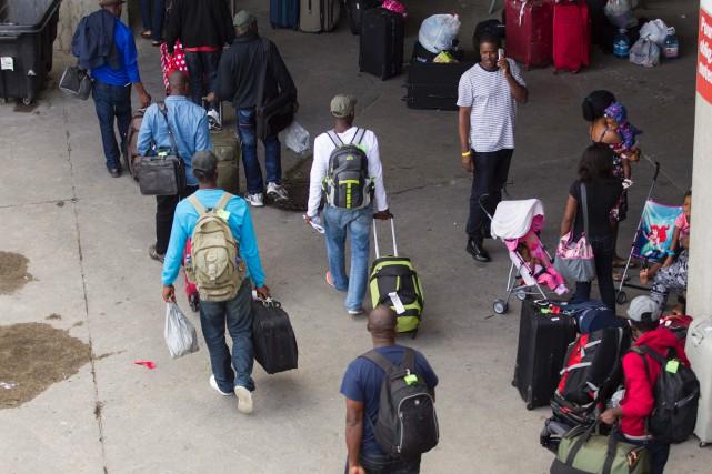 Des migrants majoritairement d'origine haïtienne arrivent en grand... (AFP)