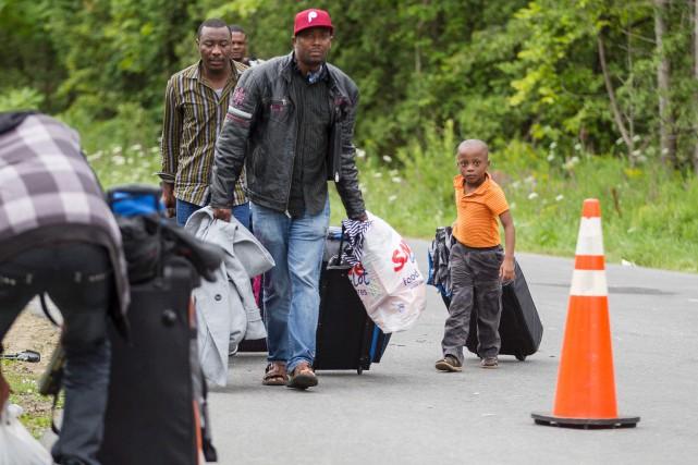 Des réfugiéscraignant d'être expulsés des États-Unis, passent illégalement... (AFP, Geoff Robins)
