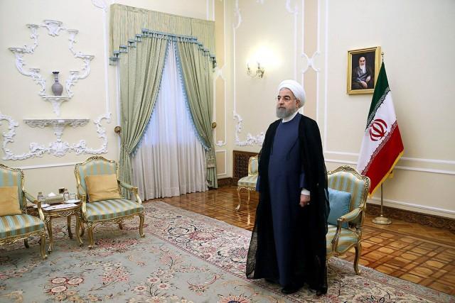 Réélu en mai, le président Rohani est critiqué... (PHOTO EBRAHIM NOROOZI, archives ASSOCIATED PRESS)