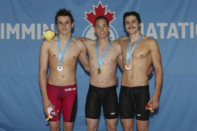 Jonathan Naisby (à gauche) a ramené une médaille... (Photo fournie par Natation Canada)
