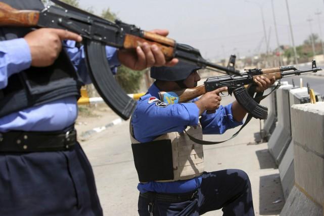 Les policiers canadiens conseilleront notamment leurs homologues irakiens... (photo archives AP)