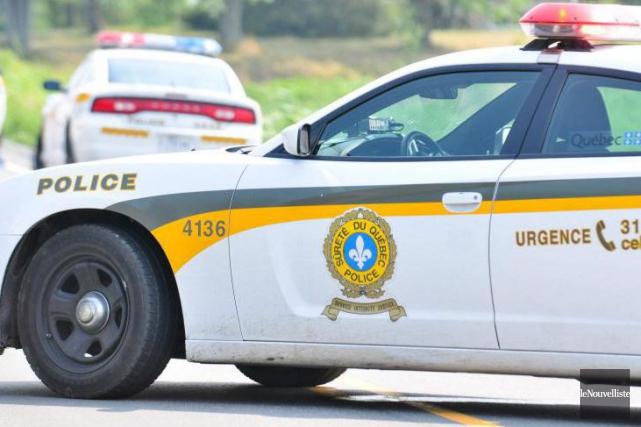 Des policiers de la Sûreté du Québec et... (Archives, Le Nouvelliste)