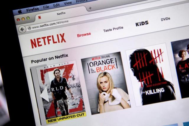 Cette hausse est la première de Netflix en... (Photo Andrew Harrer, archives Bloomberg)