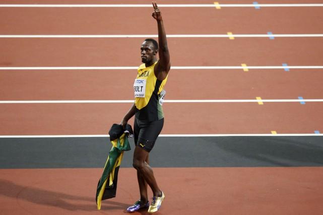 Samedi à 16h50, Usain Bolt foulera la piste... (Archives AP, Alastair Grant)
