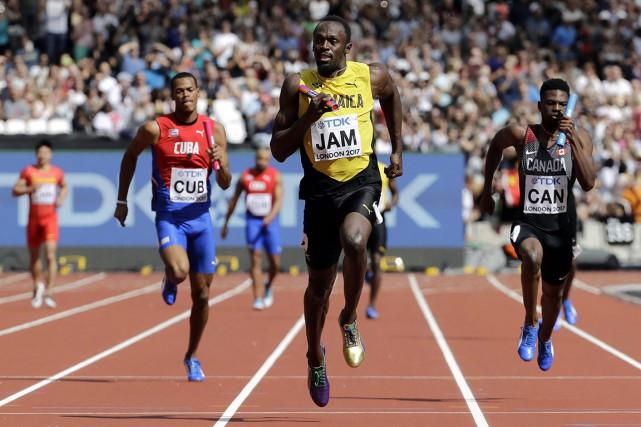 Usain Bolt et ses coéquipiers ont remporté leur... (Photo David J. Phillip, AP)