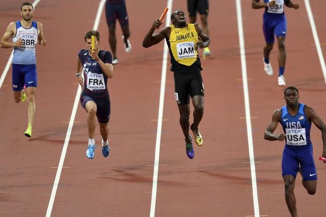 Usain Bolt a subi un claquage lors de... (AP, Martin Meissner)