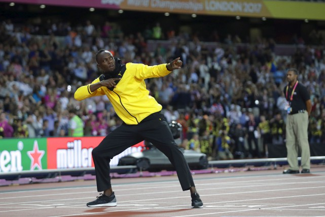 Usain Bolt a effectué à la marche un... (AP, Matt Dunham)