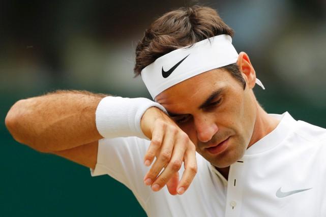 Federera précisé qu'il s'est blessé légèrement au dos... (archives AFP)