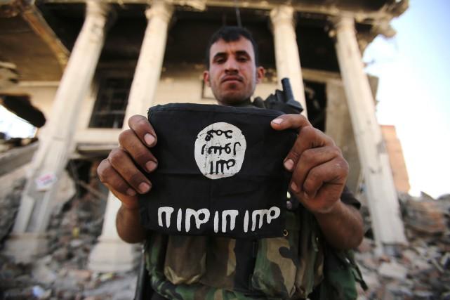 Le groupe extrémiste État islamique mène régulièrement des... (AFP)